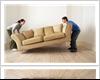 A Couple Moving the Sofa